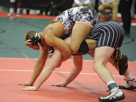 Ashland's 220-pounder Tristen Weirich tries to ride Carrollton's Brody Robinson to the mat during Friday's quarterfinals of the state wrestling tournament.