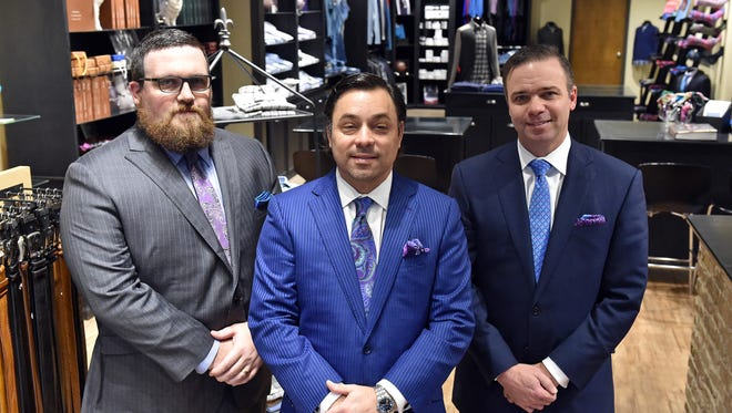 Owner Charlie Mozingo, center, stands with John Wiggins, left, and Matt Ellis in Mozingo Clothiers in Highland Village. Mozingo's will be relocating in March to a new storefront in Fondren.