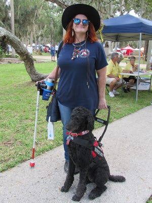 Jill Dempsey and Kissable Kate check out the 15th Annual Creekside Festival, hosted by the Flagler County Chamber of Commerce, on Saturday at Princess Place Preserve.