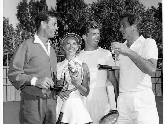 Mr. and Mrs. George Montgomery (Dinah Shore) with Glen Kramer and Don Taylor after a match at the Racquet Club c. 1950.