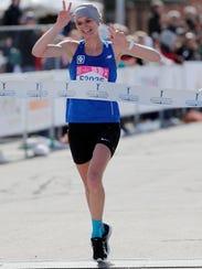 Naomi Fulton of Hartland wins the Cellcom women's half marathon Sunday.