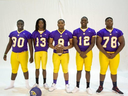 Westgate High defensive standouts tackle Da'kayln Mallery (90), free safety August Gray (13), linebacker Jaquandre Allen (8), end Oteder Foster (12) and tackle Devante Weston (78) pose during the Tigers' annual picture day.