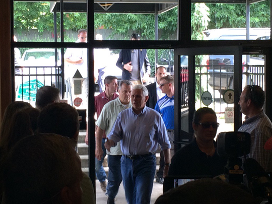 Indiana Gov. Mike Pence arrives at Price Hill Chili on Saturday.