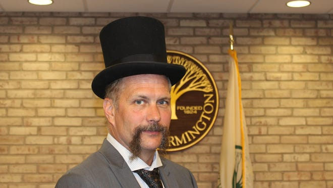"""""""Fred Warner"""" dropped by Monday's city council meeting in the form of Farmington DPW director Chuck Eudy, a frequent Warner reenactor, to express his gratitude for the recognition of his two hometowns."""