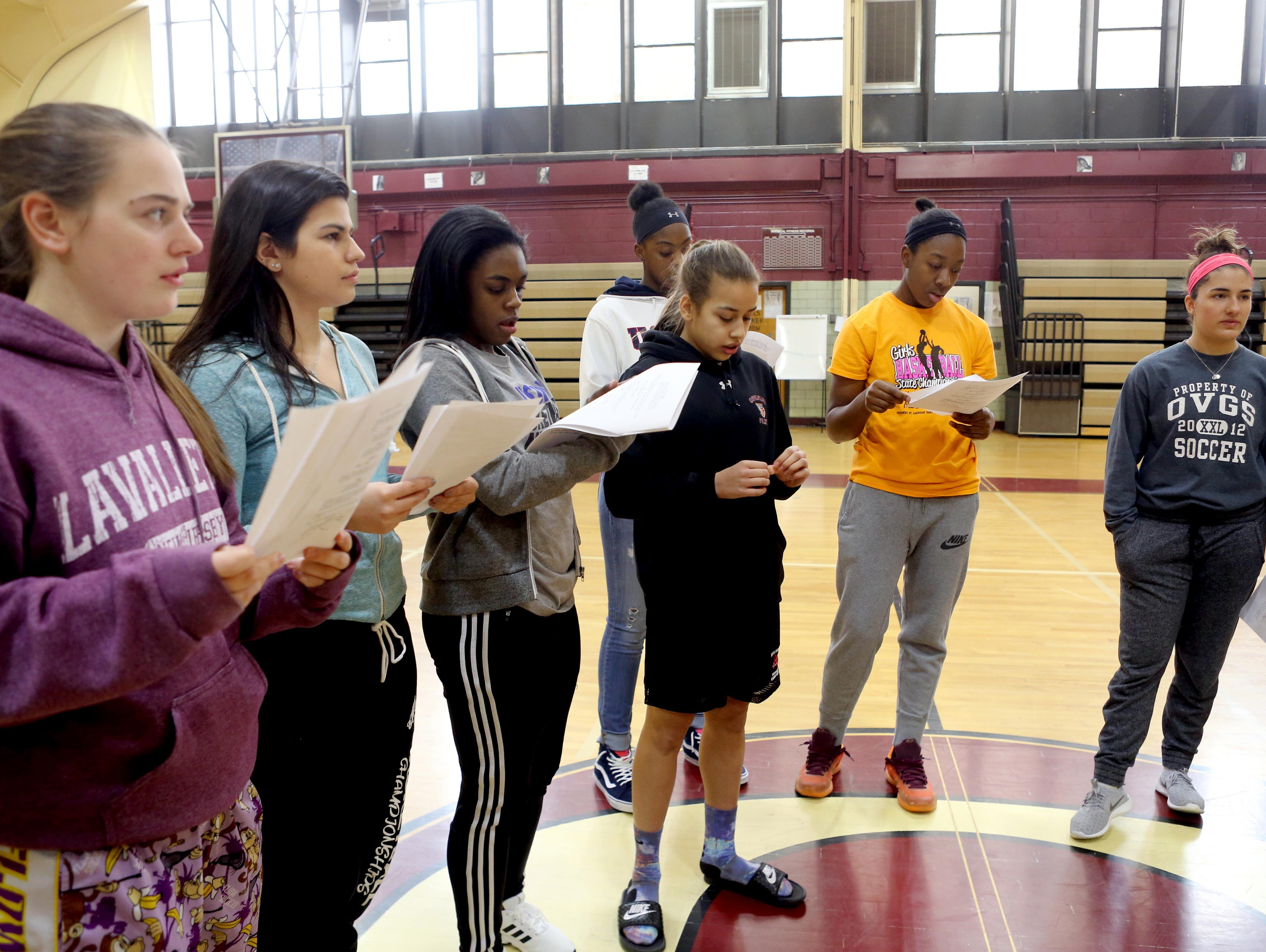Members of the Ossining High School girls basketball team go over their lines for a film that they are taking part in at the school March 24, 2016. The film, being directed by Jessica Hester, a graduate of Ossining High School, deals with the subject of menstruation and is designed to make both men and women comfortable with talking about the subject openly.