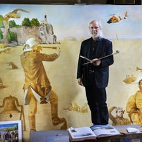Little Falls artist Charles Kapsner worked last May on his painting honoring the U.S. Coast Guard.