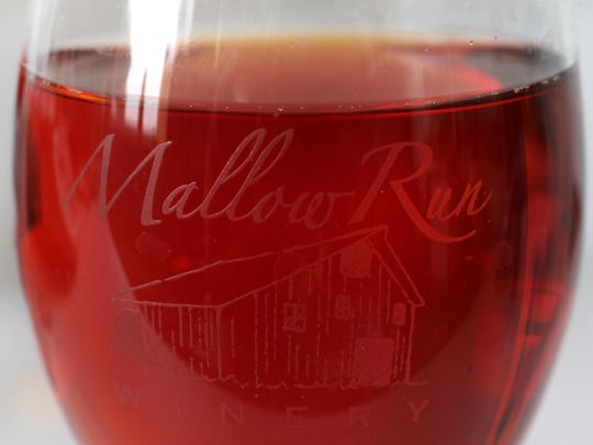 This is a glass of Strawberry Wine made by Mallow Run Winery, 6964 W. Whiteland Rd., Bargersville.