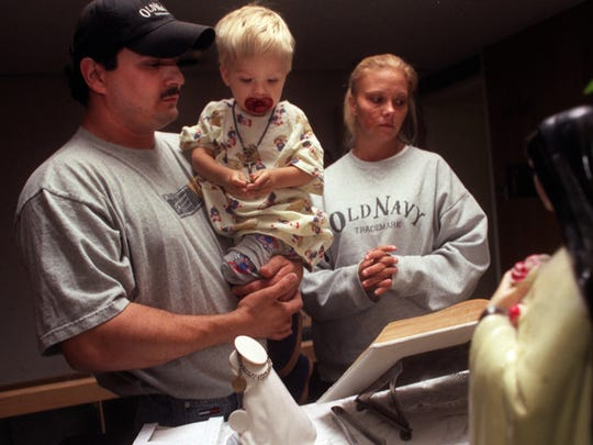 Before walking down together to hand over their 2-year-old son Kaden Cook to the doctors for his heart transplant, Kevin and Trishann Cook stopped by the chapel at C.S. Mott Children's Hospital in Ann Arbor on Sunday, Sept. 15, 2002, for moments of prayer and reflection.