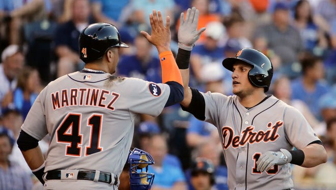 Tigers' Mikie Mahtook, right, celebrates with Victor Martinez after hitting a two-run home run during the third inning.