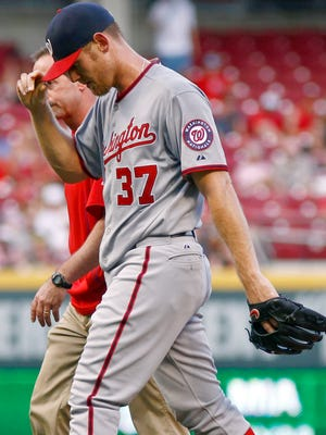 Washington Nationals starting pitcher Stephen Strasburg (37) leaves the game in the second inning against the Cincinnati Reds at Great American Ball Park.