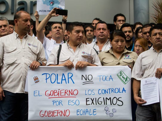 Workers of Empresas Polar demonstrate outside the company
