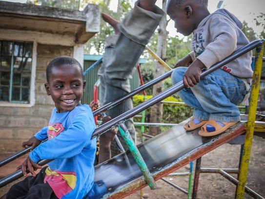 Children play at a shelter outside Nairobi, Kenya,