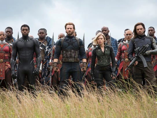 Black Panther (Chadwick Boseman, front left), Captain
