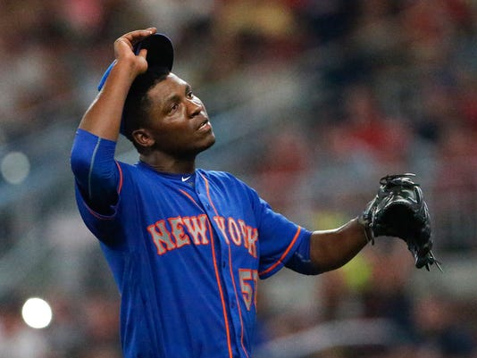 New York Mets stating pitcher Rafael Montero adjusts his cap as he leaves the field after being removed during the fifth inning of the team's baseball game against the Atlanta Braves on Friday, Sept. 15, 2017, in Atlanta. (AP Photo/John Bazemore)