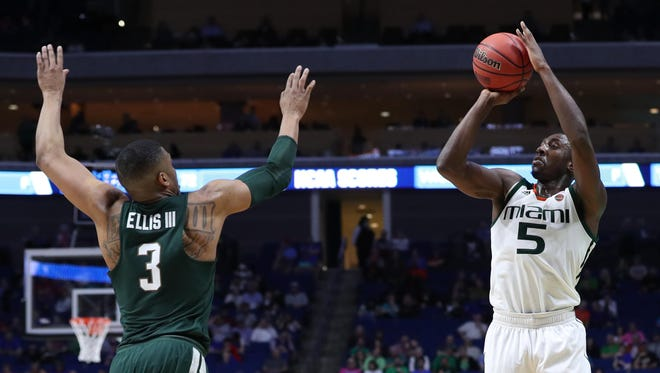 Mar 17, 2017; Tulsa, OK, USA; Miami Hurricanes guard Davon Reed (5) shoots over Michigan State Spartans guard Alvin Ellis III (3) during the second half in the first round of the 2017 NCAA Tournament at BOK Center. Mandatory Credit: Brett Rojo-USA TODAY Sports