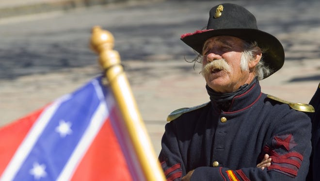 John Smith, representing the federal forces, speaks as the Sons of Confederate Veterans re-enact the secession convention of 1861 in the Mesilla Plaza in July 2012.
