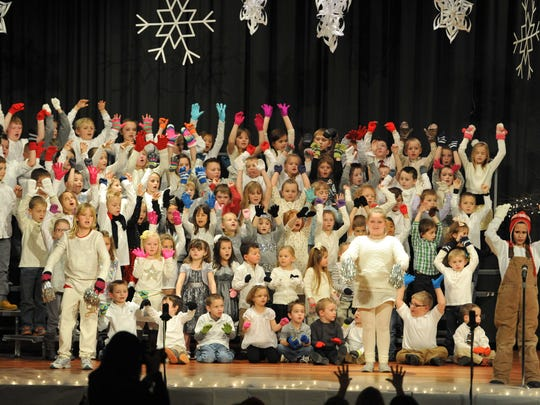 "Jonathan Woodward leads a song during the Conesville Elementary Christmas Musical ""The Mitten,"" Wednesday night at River View High School Auditorium."