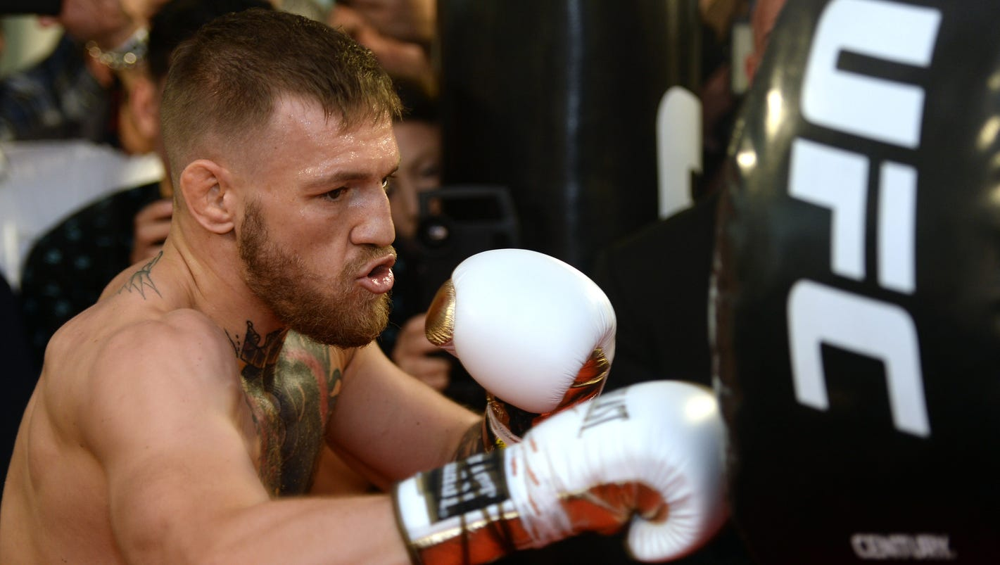 Conor McGregor pleased with decision to use lighter gloves in fight vs. Floyd Mayweather