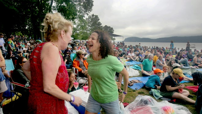 Rosemarie Fox of Croton and Judy Atropin of Brooklyn, who just met, dance together during the Clearwater Great Hudson River Revival at Croton Point Park June 17, 2107.