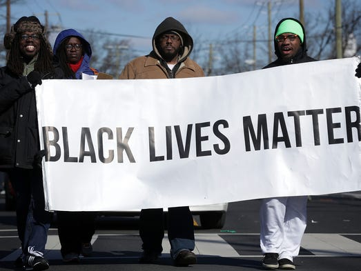 Members of Black Lives Matter DMV participate in the