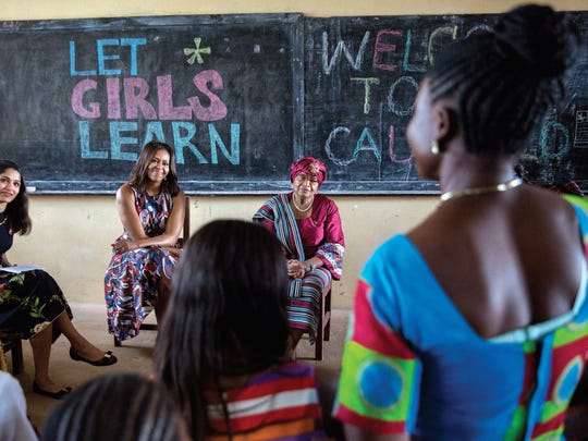 Michelle Obama takes part in a discussion with Liberian