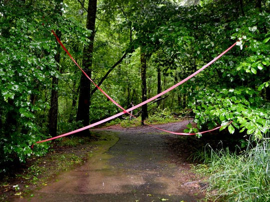 Some red tape blocks a trailhead entrance from hikers and bikers in the Bent Creek Experimental Forest on Tuesday, May 29, 2018. All of the trails in the Bent Creek Experimental Forest were closed by the U.S. Forest Service until at least Friday, June 1 due to prolonged heavy rains.