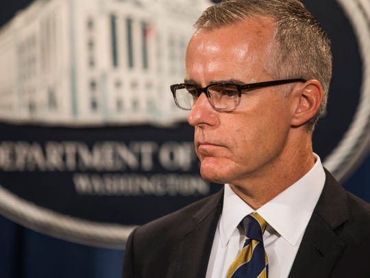 Former deputy FBI director Andrew McCabe, waits to