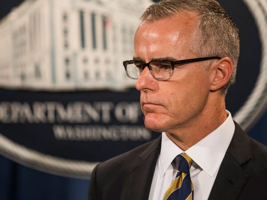 Former deputy FBI director Andrew McCabe, waits to speak at a press conference to announce the results from the Justice Department's annual national health care fraud takedown at the Department of Justice in Washington, July 13, 2017.