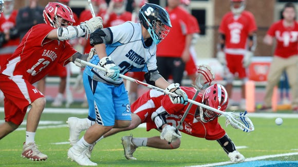 Suffern Mikey Ryan (27) scoops the ball up from North