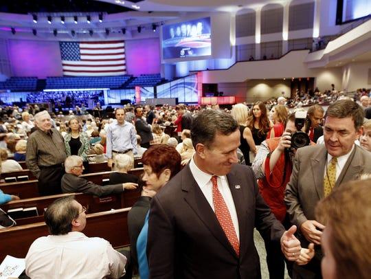 Rick Santorum greets attendees before the start of