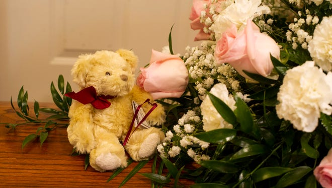 A small teddy bear sits atop Aleah Beckerle's casket during visitation services at Browning Funeral Home Monday afternoon.