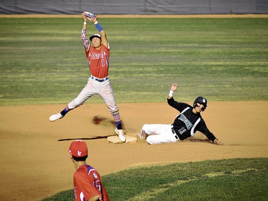 Jett Loe/Sun-News   Oñate's Fabian Reyes slides into second base against Las Cruces High's Matt Castrillo on Friday at the Field of Dreams Baseball Complex.