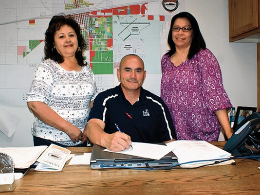 Bill Armendariz — Headlight Photo   From left, Arminda Munoz, Mayor Benny Jasso and Christine Loya met in the John Strand Municipal Building to sign a proclamation recognizing April 12-18 at National Week of the Young Child in Deming. HELP-NM and the Deming preschools are planning a festive day of activities for families on Wednesday at the Luna County Courthouse Park.
