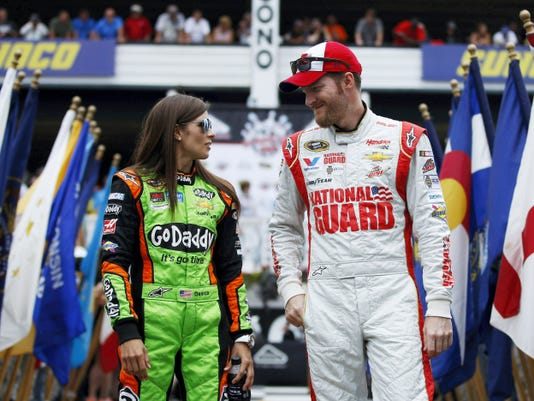 In this Aug. 3, 2014 file photo, Dale Earnhardt Jr., right, and Danica Patrick talk during driver introductions before the NASCAR Sprint Cup Series auto race at Pocono Raceway in Long Pond, Pa. The relationship between Earnhardt and Patrick will need repairing after a couple of on-track incidents late in the Saturday race at Kentucky Speedway that left both with damaged Chevys, low finishes and a little bad blood between them.