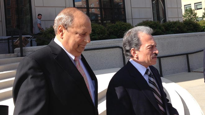 AP Sen. Thomas Libous, R-Binghamton, left, leaves federal court in White Plains, N.Y., with his attorney, Paul DerOhannesian, after being convicted of lying to federal agents Wednesday. Libous, who is the Senate?s deputy majority leader, was found guilty for lying to the FBI about arranging a high-paying job for his son. Sen. Thomas Libous, R-Binghamton, left, leaves federal court in White Plains, N.Y., with his attorney, Paul DerOhannesian, after being convicted of lying to federal agents, Wednesday, July 22, 2015. Libous, who is the Senate's deputy majority leader, was found guilty for lying to the FBI about arranging a high-paying job for his son. (AP Photo/Jim Fitzgerald)