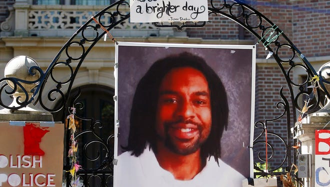 A memorial including a photo of Philando Castile adorns the gate to the governor's residence where protesters demonstrated July 25, 2016, in St. Paul against the shooting death of Castile on July 6, 2016, by St. Anthony police officer Jeronimo Yanez during a traffic stop in Falcon Heights, Minn.