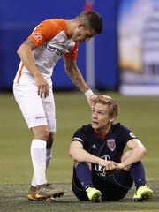 FC Cincinnati midfielder Emmanuel Ledesma (45) reaches out to Indy Eleven forward Zach Steinberger (23) in the second half of their game at Lucas Oil Stadium on Saturday, March 31, 2018. FC Cincinnati defeated the Indy Eleven 1-0.