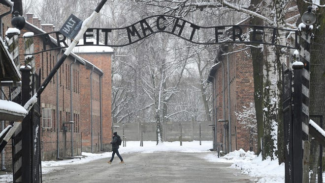 """The Jan. 26, 2015 file photo shows the entrance to the former Nazi Death Camp Auschwitz with the """"Arbeit Macht Frei"""" (Work Sets you Free) writing above, in Oswiecim, Poland."""