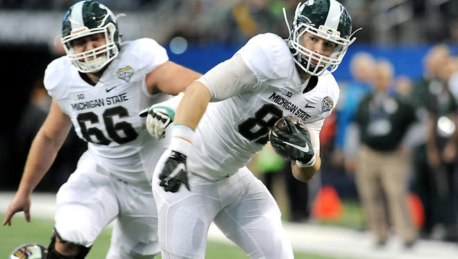 MSU tight end Josiah Price picks up a first down after a catch  against Baylor Cotton Bowl Classic on Jan. 1.