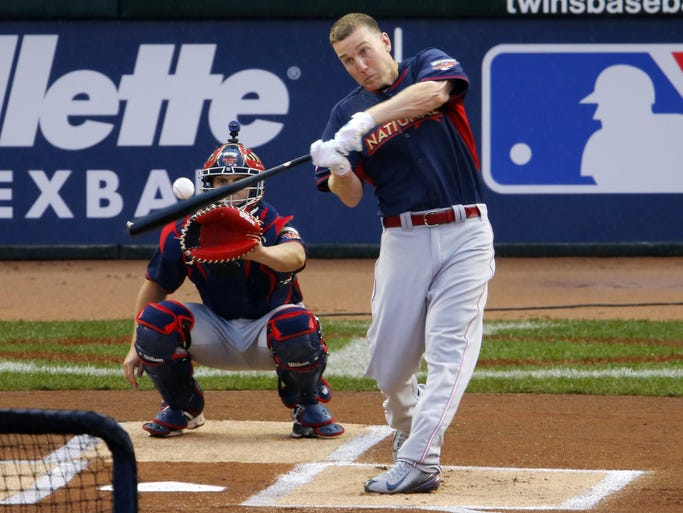National League's Todd Frazier, of the Cincinnati Reds, hits during the MLB All-Star baseball Home Run Derby, Monday, July 14, 2014, in Minneapolis. (AP Photo/Paul Sancya)
