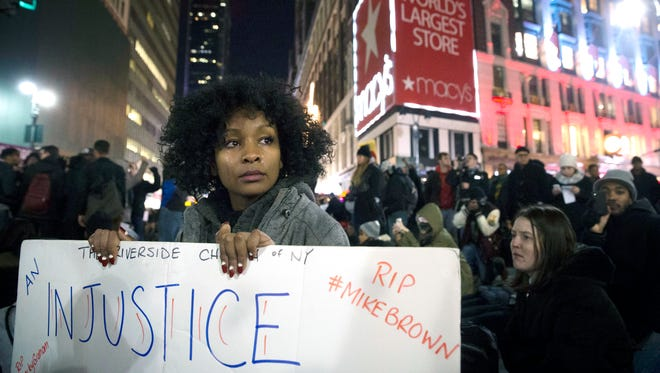 Protestor Rayyan Ali cries as she protests in Herald Square in New York on Dec. 4 in response to a grand jury's decision not to indict the police officer involved in the death of Eric Garner.