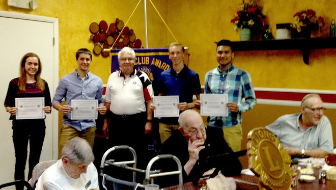 New Oxford Lions Club scholarships were presented by District Governor John Griffit, to the recipients, from left, Tamara Brown, Aaron Becker, Griffie, Ayrton Kessel and Marcos Garcia.