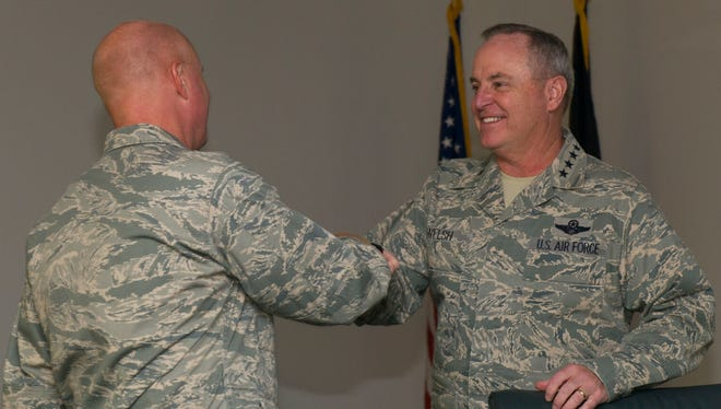 Air Force Chief of Staff Gen. Mark A. Welsh lll greets Col. Joseph Moehlmann, the 49th Materiel Maintenance Group commander, during his visit to Holloman Air Force Base on Nov. 16. During his visit, members of Team Holloman provided tours and briefings highlighting the unique missions Holloman sustains every day. Welsh also had the opportunity to review Air Force needs, requirements and investments with a sustained focus on successes and challenges Airmen face today. Welsh was joined by his wife, Betty Welsh, who addressed top Air Force issues such as suicide prevention, resiliency, exceptional family member programs and sexual assault.