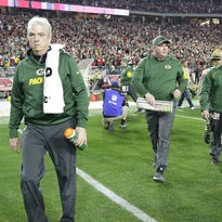 Green Bay Packers head coach Mike McCarthy walks off the field after the Packers were defeated by the Arizona Cardinals in overtime in an NFC divisional playoff game at University of Phoenix Stadium in Glendale, Ariz.