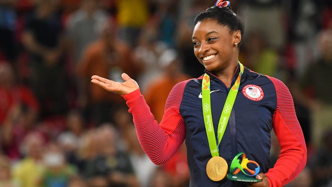 Simone Biles with her fourth gold medal of the Games.