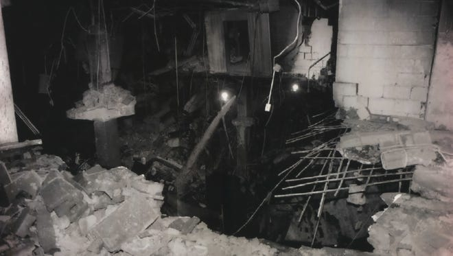 A massive crater lies beneath the World Trade Center after an explosion ripped through an underground parking garage in New York City the day before, Feb . 26, 1993.