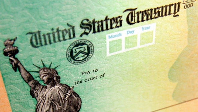 An undated file photo shows a blank United States Treasury stimulus check.