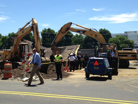 A building collapsed, trapping at least one person on Route 38 in Cherry HIll.