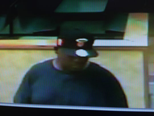 Screen capture of the suspect from security footage.