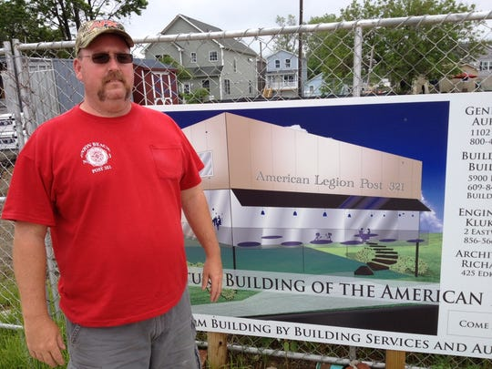 Bill Schultz, commander of the town's American Legion post, which was destroyed by the storm. (He's standing to a rendering of the proposed new $1 million elevated post on Front Street, across from the bay, which is only halfway funded so far.
